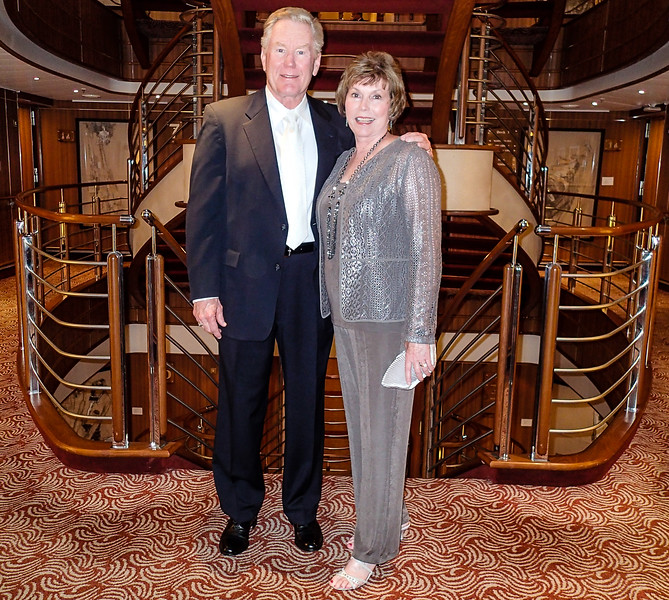 Boomer couple dressed for formal night on a cruise ship