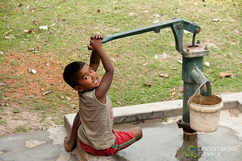Kid Pumping Water - Puthia, Bangladesh