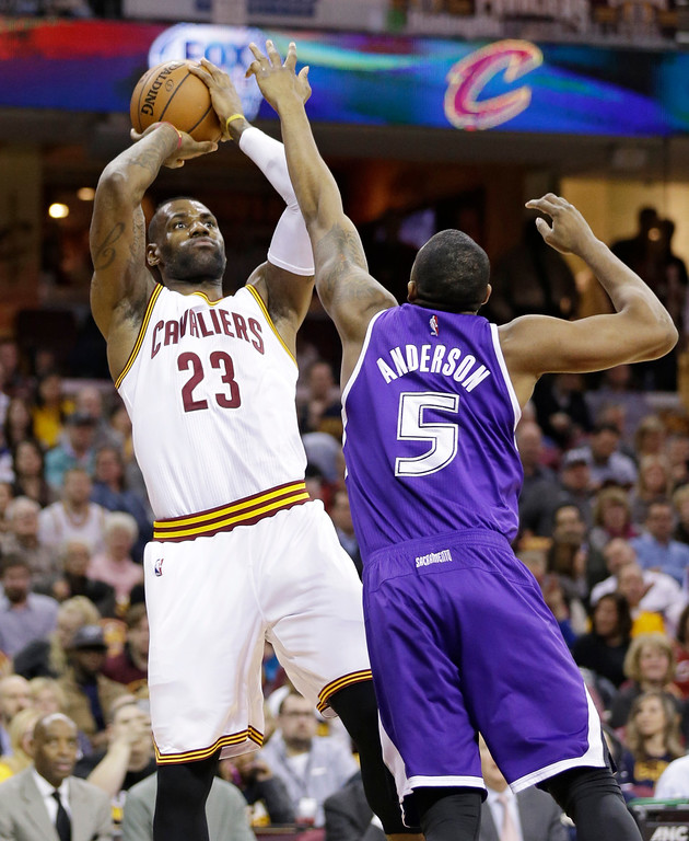 . Cleveland Cavaliers\' LeBron James (23) shoots over Sacramento Kings\' James Anderson (5) in the first half of an NBA basketball game Monday, Feb. 8, 2016, in Cleveland. (AP Photo/Tony Dejak)