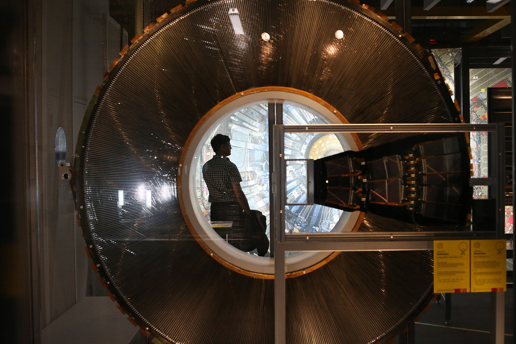 . A visitor to the Science Museum is seen through a cross section of a Transition Radiation Tracker Wheel prototype, part of the Large Hadron Collider (LHC) at the \'Collider\' exhibition on November 12, 2013 in London, England.  (Photo by Peter Macdiarmid/Getty Images)