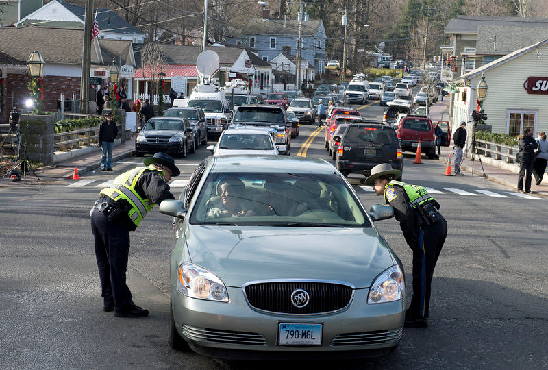 . Police deal with traffic near the downtown business area of Newtown, Connecticut, on December 15, 2012. The residents of the idyllic Connecticut town were reeling in horror from the massacre of 20 small children and six adults in one of the worst school shootings in US history. The heavily armed gunman shot dead 18 children inside Sandy Hook Elementary School, said Connecticut State Police spokesman Lieutenant Paul Vance. Two more died of their wounds in hospital.    DON EMMERT/AFP/Getty Images