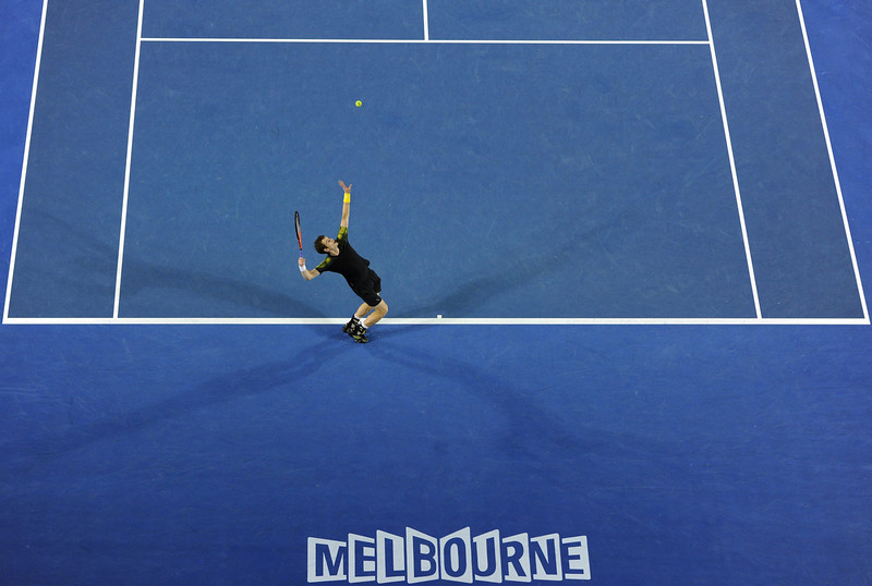 . Britain\'s Andy Murray serves against Switzerland\'s Roger Federer during their men\'s singles semi-final match on day 12 of the Australian Open tennis tournament in Melbourne on January 25, 2013.  MANAN VATSYAYANA/AFP/Getty Images