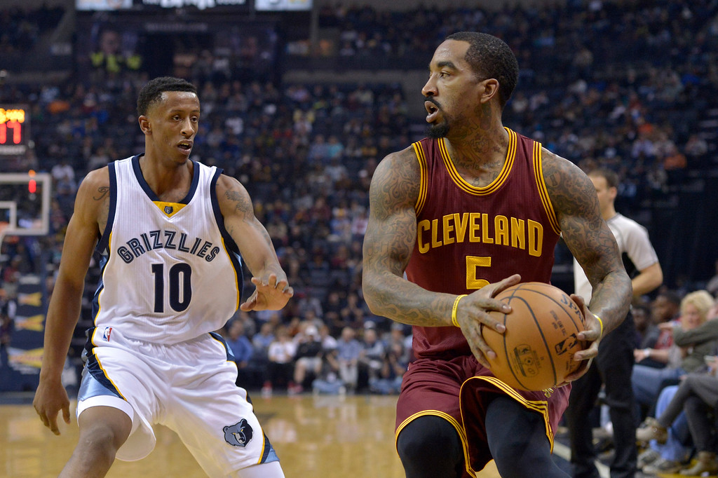 . Cleveland Cavaliers guard J.R. Smith (5) controls the ball against Memphis Grizzlies forward Troy Williams (10) in the first half of an NBA basketball game Wednesday, Dec. 14, 2016, in Memphis, Tenn. (AP Photo/Brandon Dill)