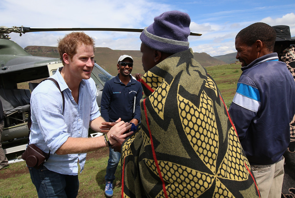 . Prince Harry arrives for a visit to a herd boy night school constructed by Sentebale on December 8, 2014 in Mokhotlong, Lesotho. Prince Harry was visiting Lesotho to see the work of his charity Sentebale. Sentebale provides healthcare and education to vulnerable children in Lesotho, Southern Africa.  (Photo by Chris Jackson/Getty Images for Sentebale)
