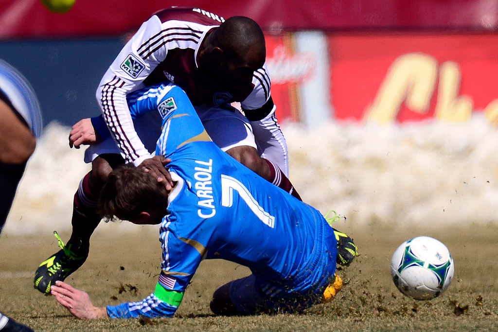 . COMMERCE CITY, CO - MARCH 10: Marvell Wynne (22) of the Colorado Rapids tangles with Brian Carroll (7) of the Philadelphia Unionduring the first half of action. The Colorado Rapids play the Philadelphia Union at Dick\'s Sporting Goods Park. (Photo By AAron Ontiveroz/The Denver Post)