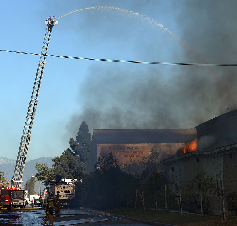 . Firefighters from Montebello and surrounding agencies from the cities of Downey, Alhambra, Monterey Park fire dept. fight a three alarm fire at Belmont Fibers Inc. along Chapin Road in Montebello, Calif., on Friday, Jan. 17, 2014. (Keith Birmingham Pasadena Star-News)