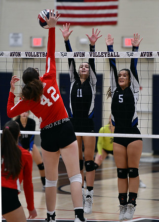 11/7/2019 Mike Orazzi | StaffrBristol Eastern's Ryley Plourde (11) and Brooke Dorsio (5) and Conard High School's Avery Theriault (42) during the CCC girls volleyball tournament at Avon High School on Thursday. r