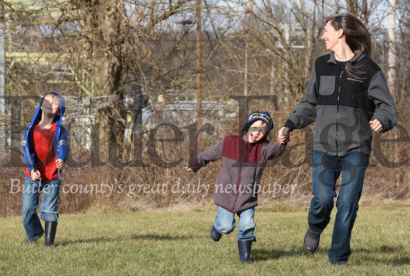 Harold Aughton/Butler Eagle: Emily Smith of Butle played tag with her two boys, Egan, 6, left, and Murphy, 4, Monday afternoon, January 13, 2020.