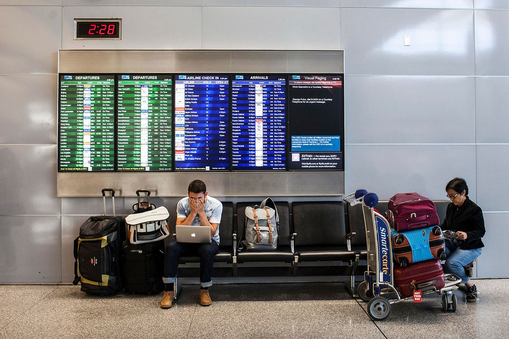 . Passengers wait for their delayed flights after an Asiana Airlines Boeing 777 crashed and burst into flames as it landed at San Francisco International Airport in San Francisco, California July 6, 2013.  REUTERS/Jana Asenbrennerova