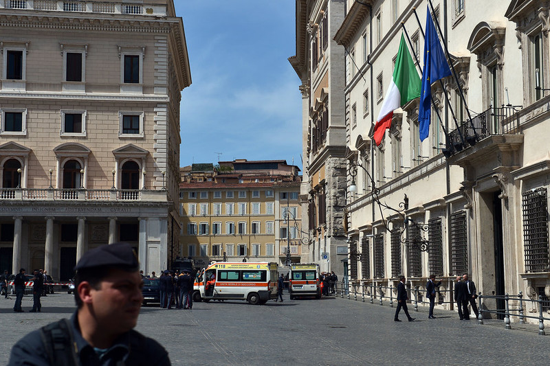 . Ambulances arrive to take away two policemen who were shot on April 28, 2013 outside the Italian Prime ministers office in Rome. The incident occurred about a kilometer away from the presidential palace where Prime Minister Enrico Letta and his ministers took the oath of office. GABRIEL BOUYS/AFP/Getty Images