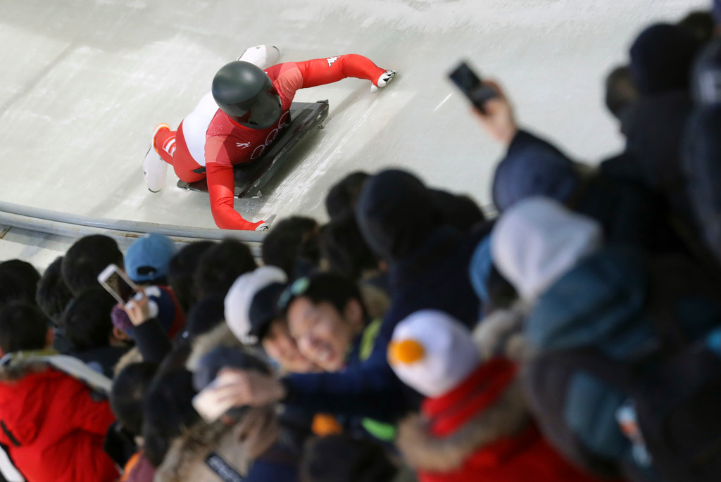 . Matthias Guggenberger of Austria brakes in the finish area during the men\'s skeleton competition at the 2018 Winter Olympics in Pyeongchang, South Korea, Thursday, Feb. 15, 2018. (AP Photo/Michael Sohn)