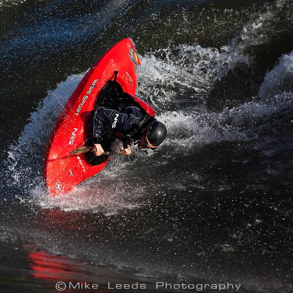 Dan Simenc throwing an Air Blunt at the Bladder Wave, Main Payette River in Idaho.