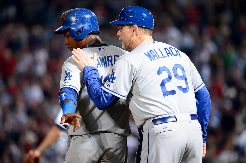 . Los Angeles Dodgers\'s third base coach Tim Wallach talks to Hanley Ramirez as he advances to third in the sixth in game 2 of the playoffs Thursday, October 4, 2013 at Turner Field in Atlanta, Georgia. Braves defeated Dodgers 4-3.(Photo by Sarah Reingewirtz/Pasadena Star- News)