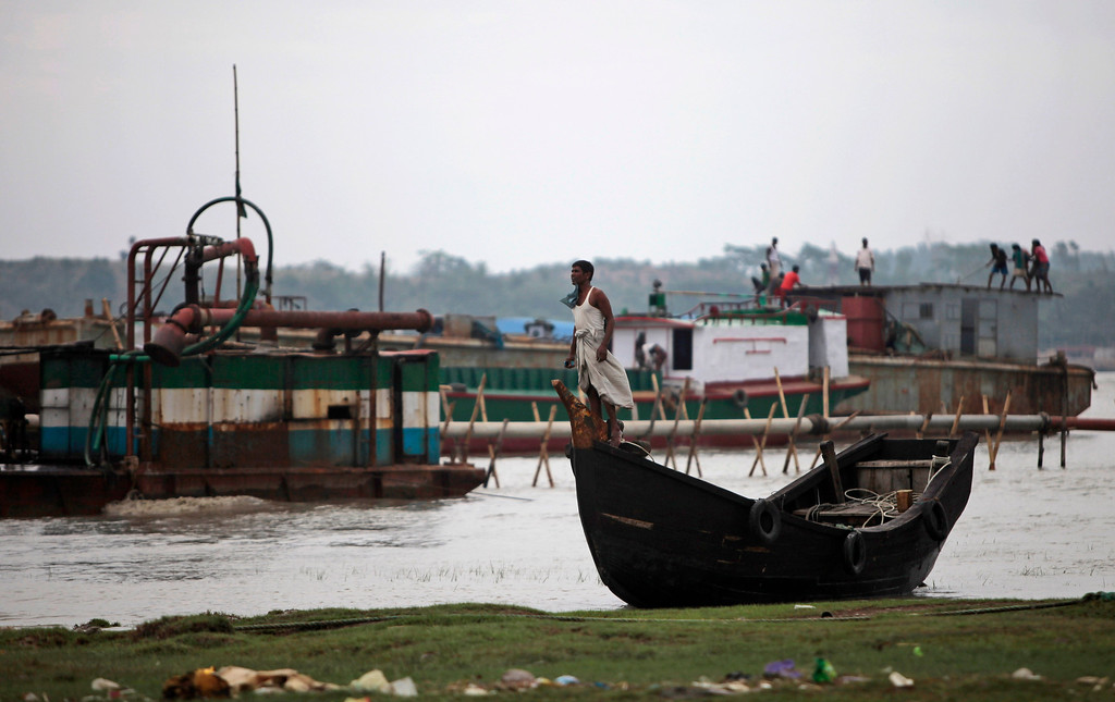 . Bangladeshis observe the weather ahead of the coming of tropical cyclone Mahasen, in Chittagong, Bangladesh, Wednesday, May 15, 2013. People living in coastal areas in Bangladesh and Myanmar are being evacuated as cyclone Mahasen appears to make landfall late Thursday or early Friday, according to news reports. (AP Photo/A.M. Ahad)