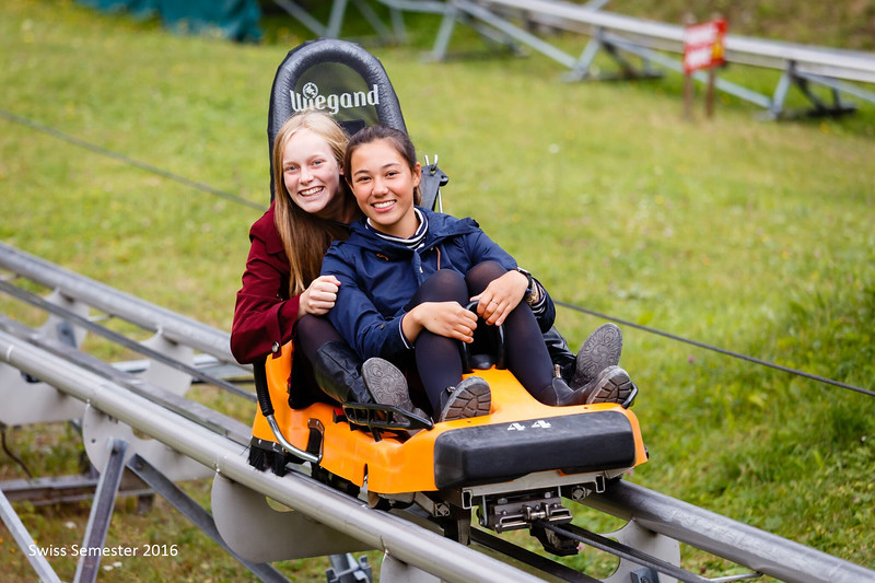 Abigael and Mia heading up the alpine slide