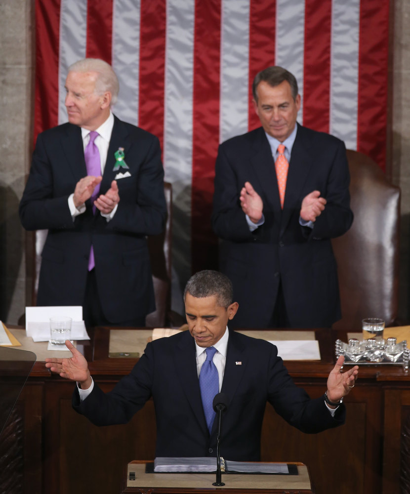 Description of . Flanked by U.S. Vice President Joe Biden (L) and Speaker of the House John Boehner (R-OH) (R), U.S. President Barack Obama (C) delivers his State of the Union speech before a joint session of Congress at the U.S. Capitol February 12, 2013 in Washington, DC. Facing a divided Congress, Obama focused his speech on new initiatives designed to stimulate the U.S. economy and said,