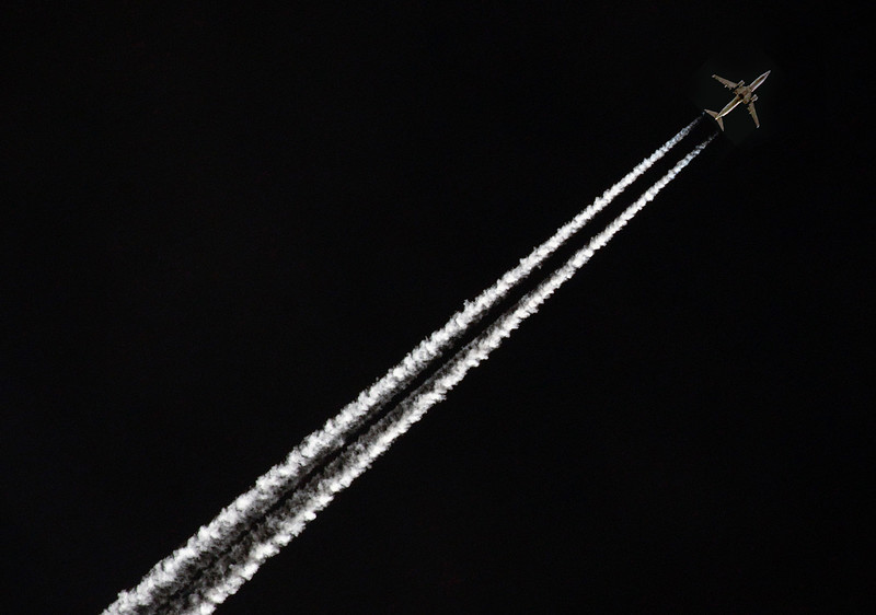 Twin-engine jet's contrails, 6 miles above us