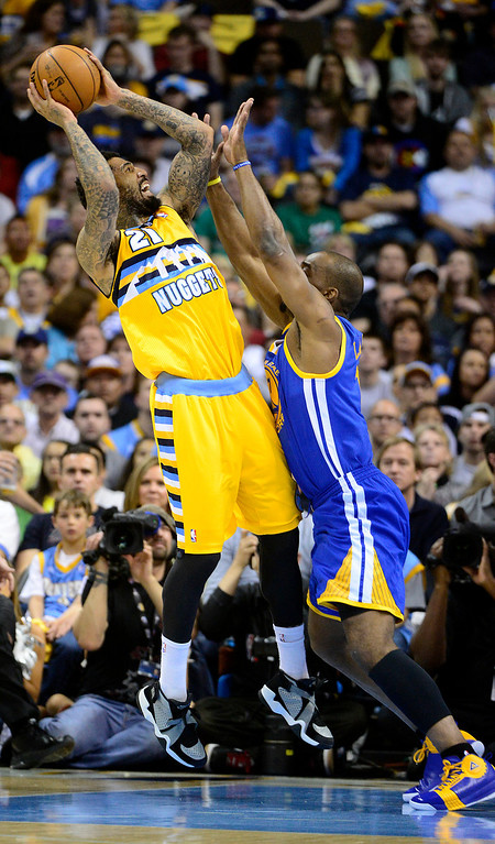 . DENVER, CO. - APRIL 20: Denver Nuggets shooting guard Wilson Chandler (21) puts up a shot in the first quarter while being guarded by Golden State Warriors power forward Carl Landry (7). The Denver Nuggets took on the Golden State Warriors in Game 1 of the Western Conference First Round Series at the Pepsi Center in Denver, Colo. on April 20, 2013. (Photo by AAron Ontiveroz/The Denver Post)
