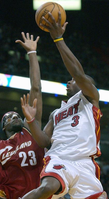 . Cleveland Cavaliers\' Lebron James (23) blocks a shot by Miami Heat\'s Dwyane Wade (3) in the fourth quarter Thursday, Feb. 3, 2005 in Miami. Miami won, 100-88. (AP Photo/Alan Diaz)