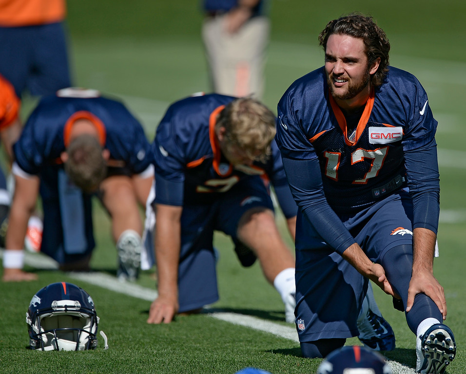 . Denver Broncos quarterback Brock Osweiler (17) stretches during the first day of the Denver Broncos 2014 training camp July 24, 2014 at Dove Valley. (Photo by John Leyba/The Denver Post)