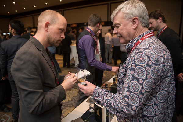 DAVID LIPNOWSKI / WINNIPEG FREE PRESS  Winnipeg Free Press wine writer Ben MacPhee-Sigurdson (left) speaks with Andy Dunn of Springbank Distillery during the 2017 Winnipeg Whiskey Festival Friday March 3, 2017 at the Fairmont Hotel.