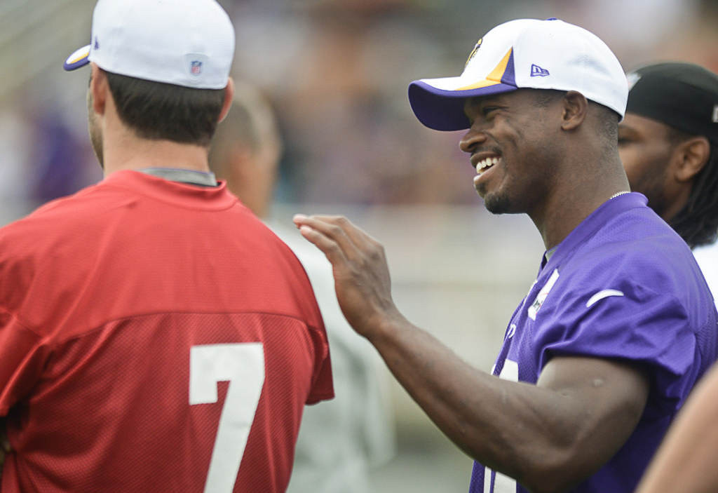 . Peterson, right, chats with quarterback Christian Ponder. (Pioneer Press: Ben Garvin)