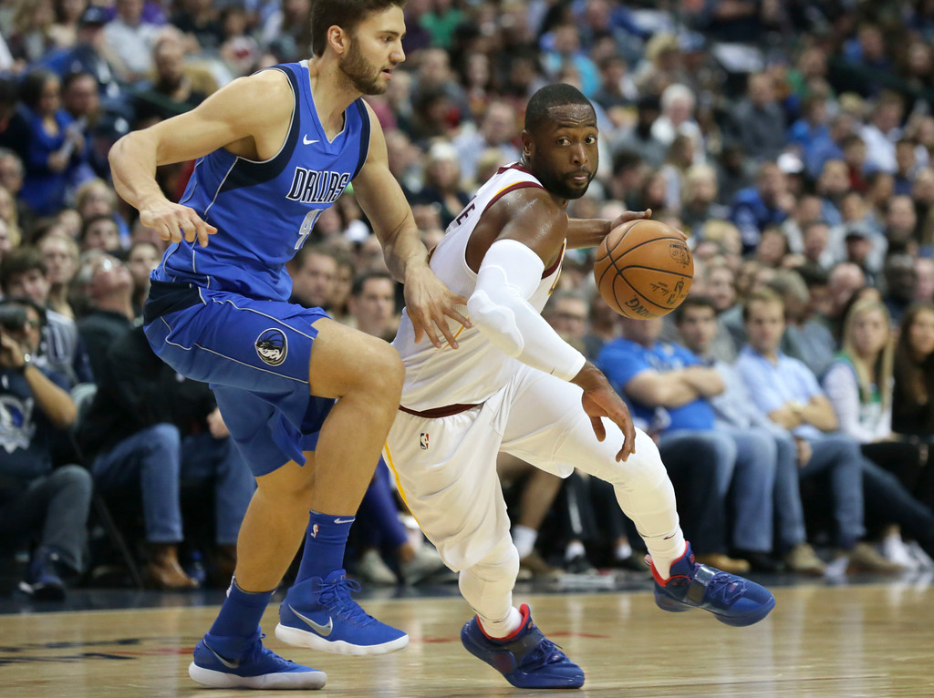 . Cleveland Cavaliers guard Dwyane Wade, right, drives against Dallas Mavericks forward Maximilian Kleber (42), of Germany, during the first half of an NBA basketball game in Dallas, Saturday, Nov. 11, 2017. (AP Photo/LM Otero)