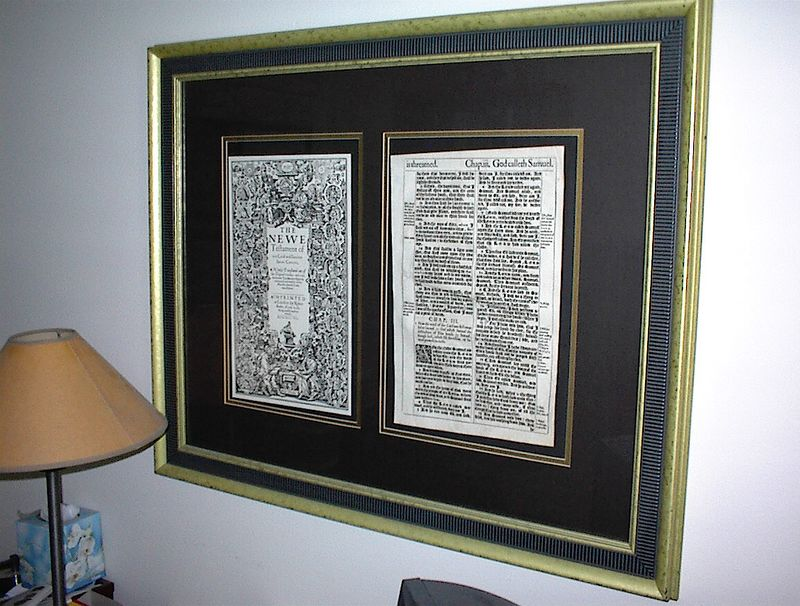 A framed page from a first printing of the King James bible, printed in 1611. The cover page opposite is a facsimile.