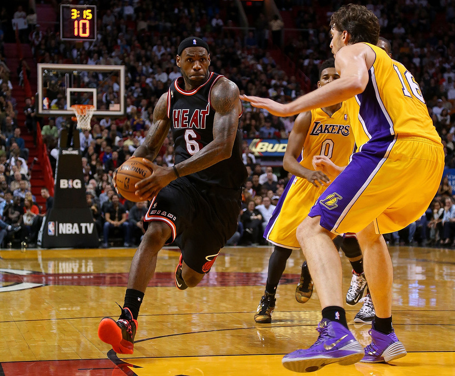 . LeBron James #6 of the Miami Heat drives on Pau Gasol #16 of the Los Angeles Lakers during a game at American Airlines Arena on January 23, 2014 in Miami, Florida.   (Photo by Mike Ehrmann/Getty Images)