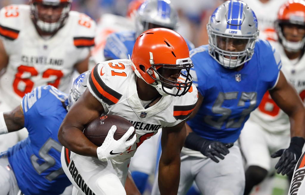 . Cleveland Browns running back Nick Chubb (31) rushes against the Detroit Lions defense during the first half of an NFL football preseason game, Thursday, Aug. 30, 2018, in Detroit. (AP Photo/Carlos Osorio)