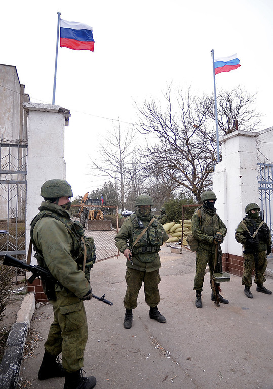 . Russian soldiers stand at the gate after taking contol of the navy south headquarters base in Novoozerne on  March 19, 2014.  AFP PHOTO/ Filippo MONTEFORTE/AFP/Getty Images