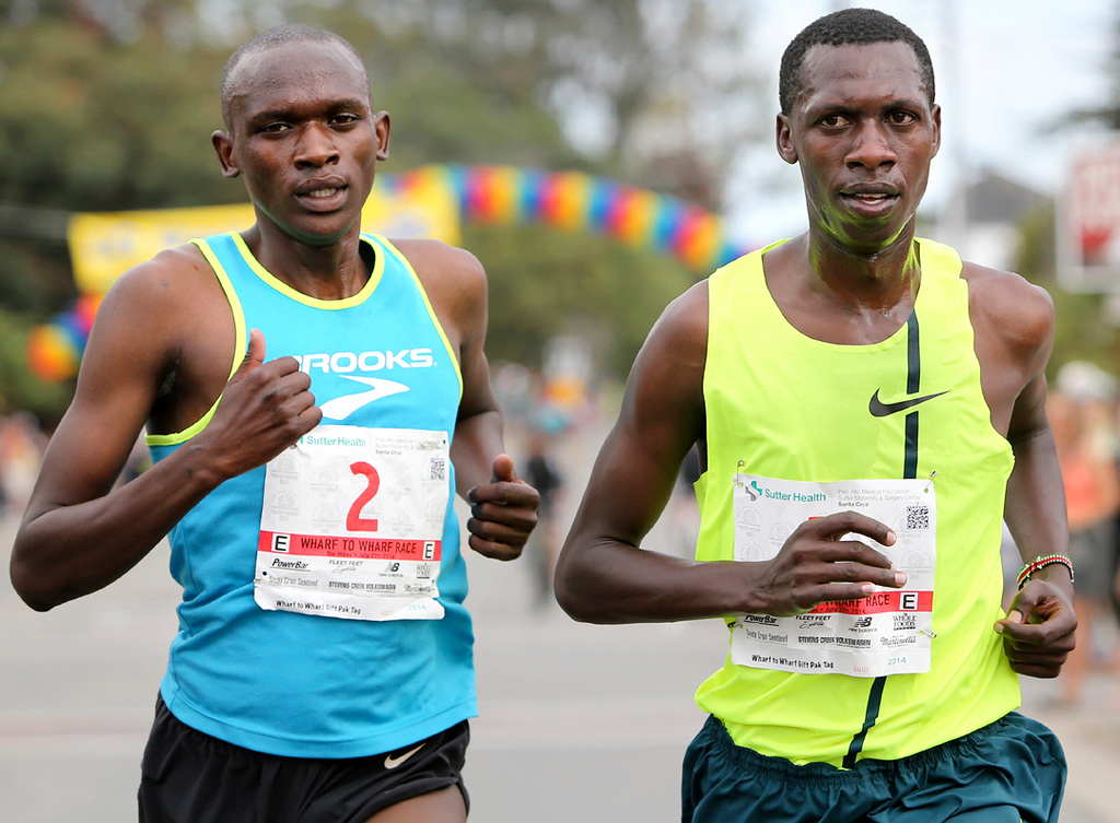 . Wharf to Wharf winner Simon Ndirangu of Kenya overtakes last year\'s winner Nelson Oyugi as the pair pull away from the rest of the elite runners during the 6-mile road race in Santa Cruz on Sunday. (Kevin Johnson -- Santa Cruz Sentinel) (Kevin Johnson -- Santa Cruz Sentinel)
