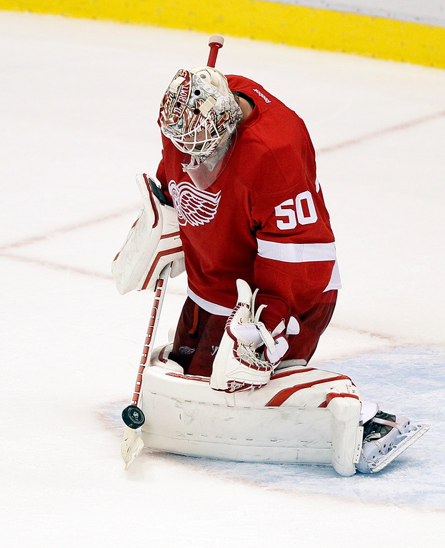 . Detroit Red Wings goalie Jonas Gustavsson (50), of Sweden, makes a save during the third period of an NHL hockey game against the Toronto Maple Leafs Saturday, Oct. 18, 2014, in Detroit. The Red Wings defeated the Maple Leafs 1-0 in overtime. (AP Photo/Duane Burleson)