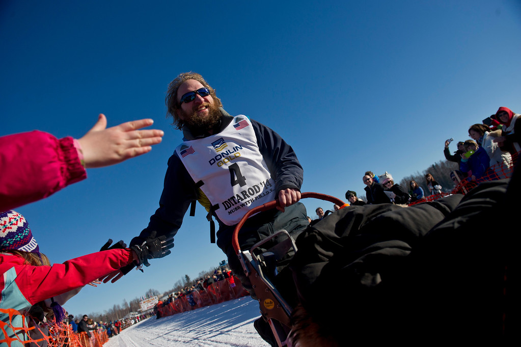 . Gus Guenther of Clam Gulch, Alaska, leaves the starting line of the Iditarod Trail Sled Dog Race on Sunday, March 2, 2014, in Willow, Alaska. (AP Photo/Anchorage Daily News, Marc Lester)