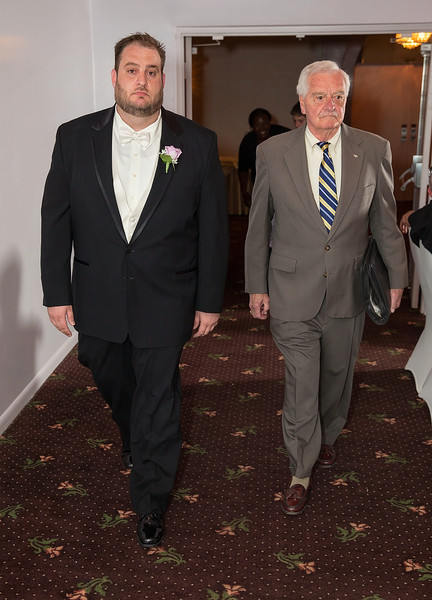 Groom and Officiant walking down aisle.jpg