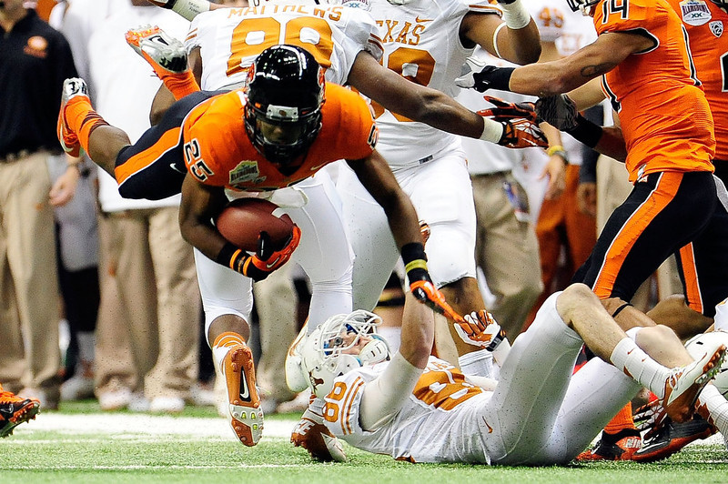 . Cade McCrary #86 of the University of Texas Longhorns trips up Ryan Murphy #25 of the Oregon State Beavers during the Valero Alamo Bowl at the Alamodome on December 29, 2012 in San Antonio, Texas.  (Photo by Stacy Revere/Getty Images)