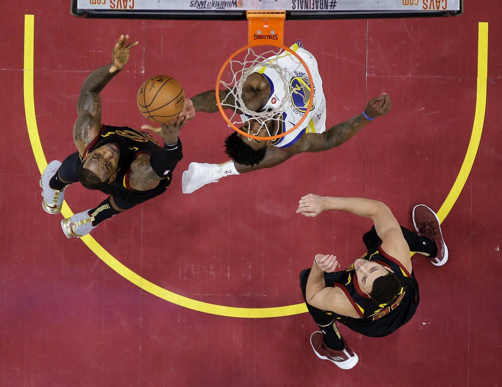 . Golden State Warriors\' Jordan Bell and Cleveland Cavaliers\' LeBron James, left, vie for a rebound during the second half of Game 3 of basketball\'s NBA Finals, Wednesday, June 6, 2018, in Cleveland. The Warriors defeated the Cavaliers 110-102 to take a 3-0 lead in the series. (AP Photo/Carlos Osorio, Pool)