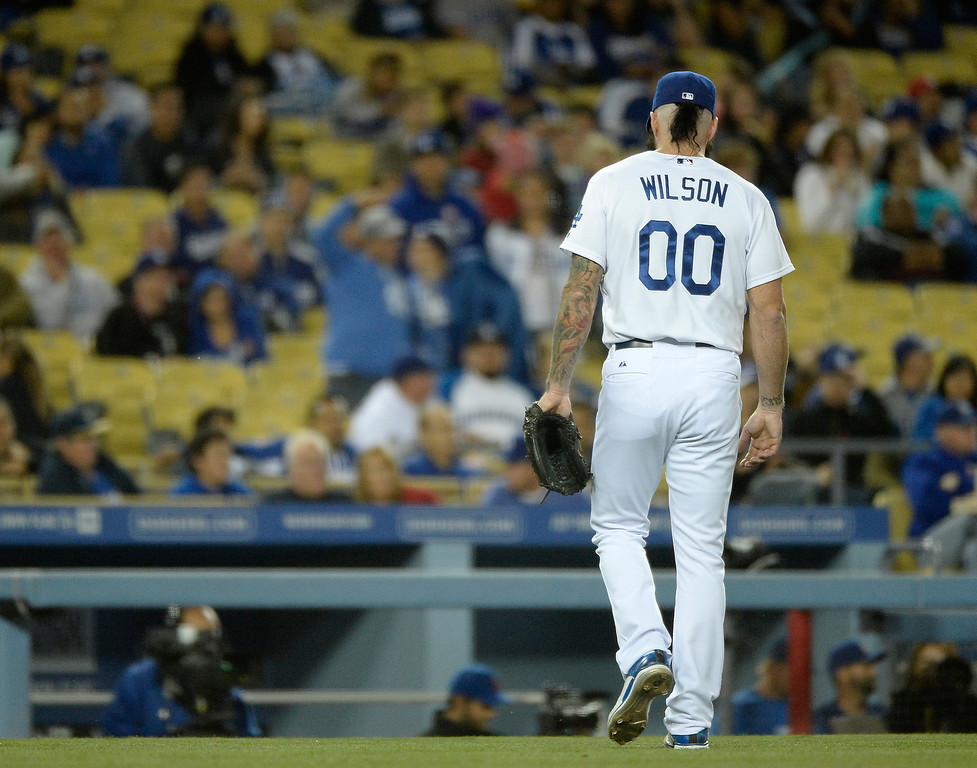 . LOS ANGELES, CA - APRIL 26:  Brian Wilson #00 leaves the game unable to retire a Colorado Rockies player in relief during the ninth inning at Dodger Stadium on April 26, 2014 in Los Angeles, California.  (Photo by Harry How/Getty Images)
