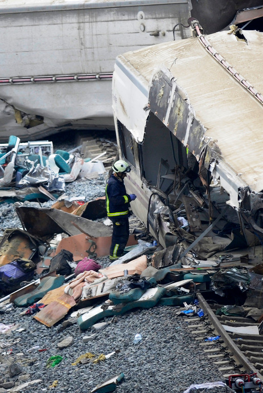 . A rescuers checks a train\'s car at the site of a train accident near the city of Santiago de Compostela on July 25, 2013.     AFP PHOTO/ MIGUEL  RIOPA/AFP/Getty Images