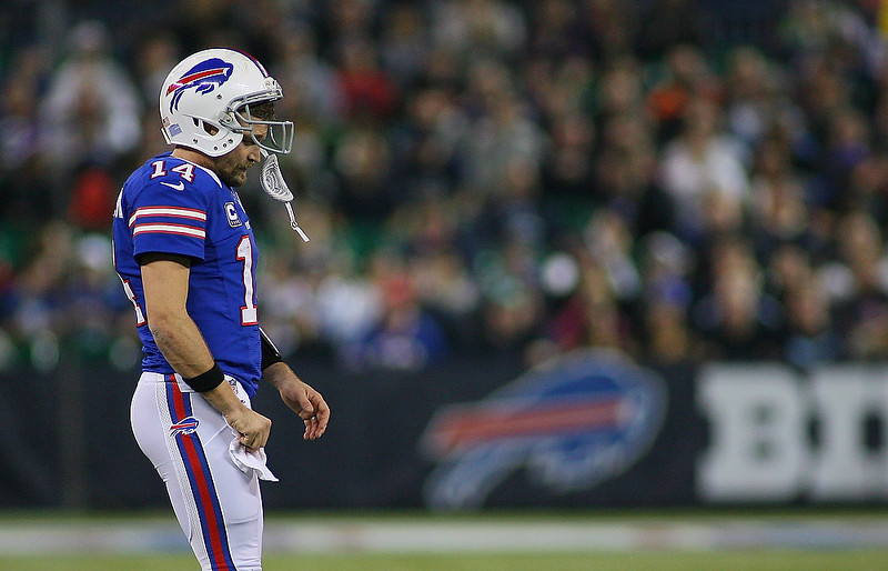 . Ryan Fitzpatrick #14 of the Buffalo Bills walks onto the field late in the game against the Seattle Seahawks at Rogers Centre on December 16, 2012 in Toronto, Ontario.Seattle won 50-17.  (Photo by Rick Stewart/Getty Images)