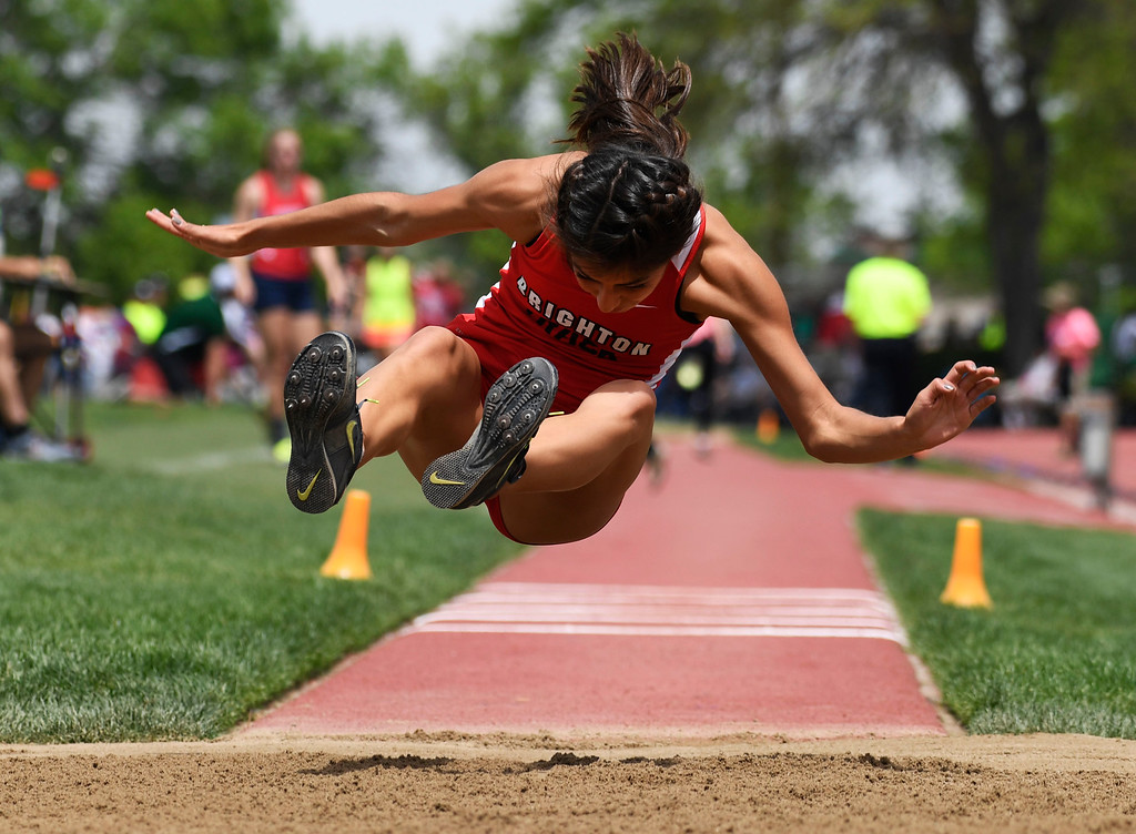 . Kiana Gomez, Brighton, eyes her landing in the sand pit during the girls 5A triple jump finals at the Colorado Track and Field State Championships at Jeffco Stadium May 21, 2016. (Photo by Andy Cross/The Denver Post)