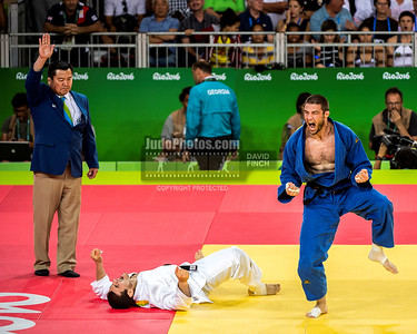 RIO DE JANEIRO, BRAZIL, AUGUST 09: Referee Akinobu Osako of Japan signals ippon (10 points) while Travis Stevens of the United States (blue) celebrates having strangled strangled Avtandili Tchrikishvili of Georgia into submission to reach the u81kg final during day 4 of the 2016 Rio Olympic Judo on Tuesday, August 09 at the Carioca Arenas, Barra, Rio de Janeiro, Brazil. (Photo © by David Finch. All rights reserved. Including image always credited to David Finch)Travis Stevens;Avtandili Tchrikishvili;Akinobu Osako