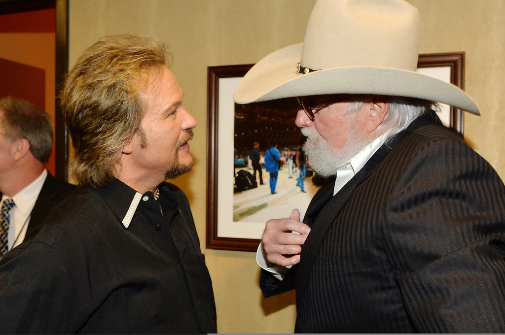 . Country musicians Travis Tritt (L) and Charlie Daniels attend the funeral service for George Jones at The Grand Ole Opry on May 2, 2013 in Nashville, Tennessee. (Photo by Rick Diamond/Getty Images for GJ Memorial)