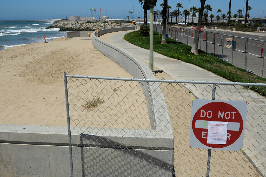 . A section of the sidewalk at Hueneme Beach has been fenced off where sand has washed away during the past several months, Monday, July 15, 2013. (Michael Owen Baker/L.A. Daily News)