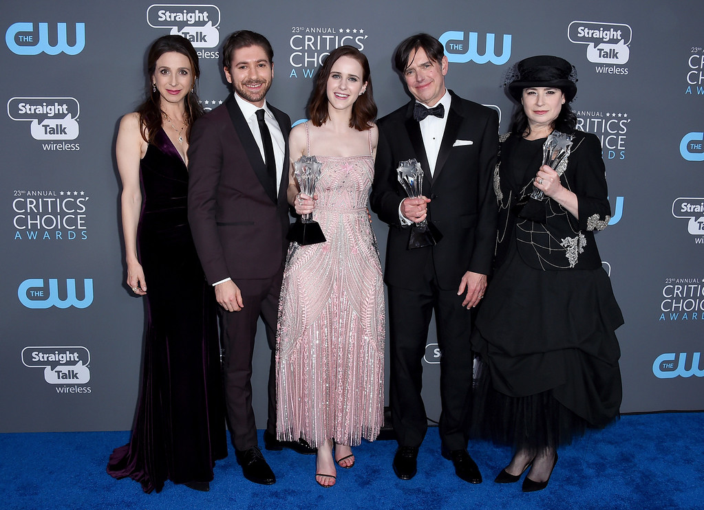 ". Marin Hinkle, from left, Michael Zegen, Rachel Brosnahan, Daniel Palladino, and Amy Sherman-Palladino, winners of the award for best comedy series for ""The Marvelous Mrs. Maisel\"", pose in the press room at the 23rd annual Critics\' Choice Awards at the Barker Hangar on Thursday, Jan. 11, 2018, in Santa Monica, Calif. (Photo by Jordan Strauss/Invision/AP)"