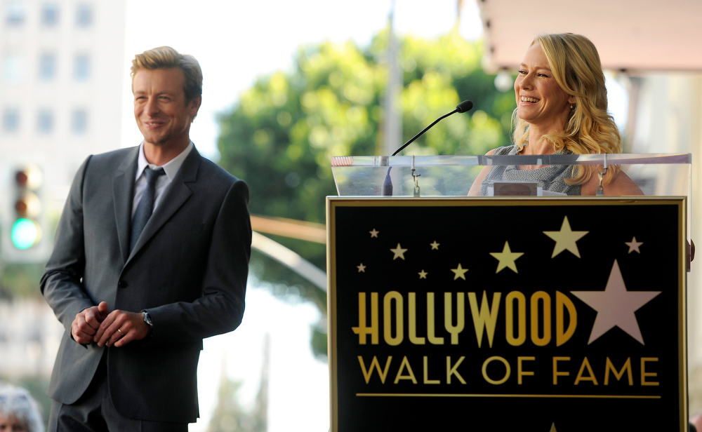 ". Actress Naomi Watts, right, delivers a speech at a ceremony to award actor Simon Baker, left, a star on the Hollywood Walk of Fame, on Thursday, Feb. 14, 2013 in Los Angeles. Australian performers Watts and Baker worked together in the 2005 film ""The Ring Two.\"" (Photo by Chris Pizzello/Invision/AP)"