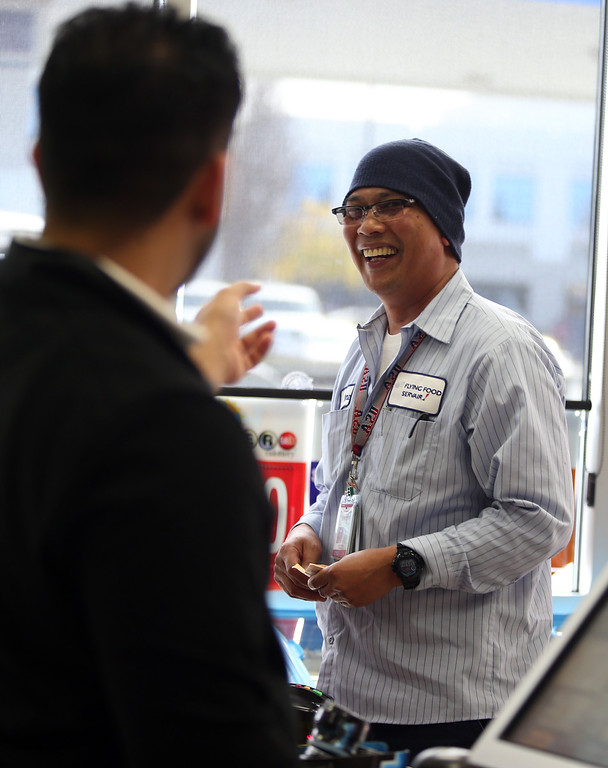 . Regular customer Jaime Caparas, of Milpitas, stops by to check the lottery tickets he purchased at the Dixon Landing Chevron gas station that sold the winning Powerball lottery ticket worth $425 Million in Milpitas, Calif., Thursday, Feb. 20, 2014. Caparas did not win but kept his smile and plans to keep playing. The owners of the station will receive a one million dollar bonus for selling the ticket. (Anda Chu/Bay Area News Group)
