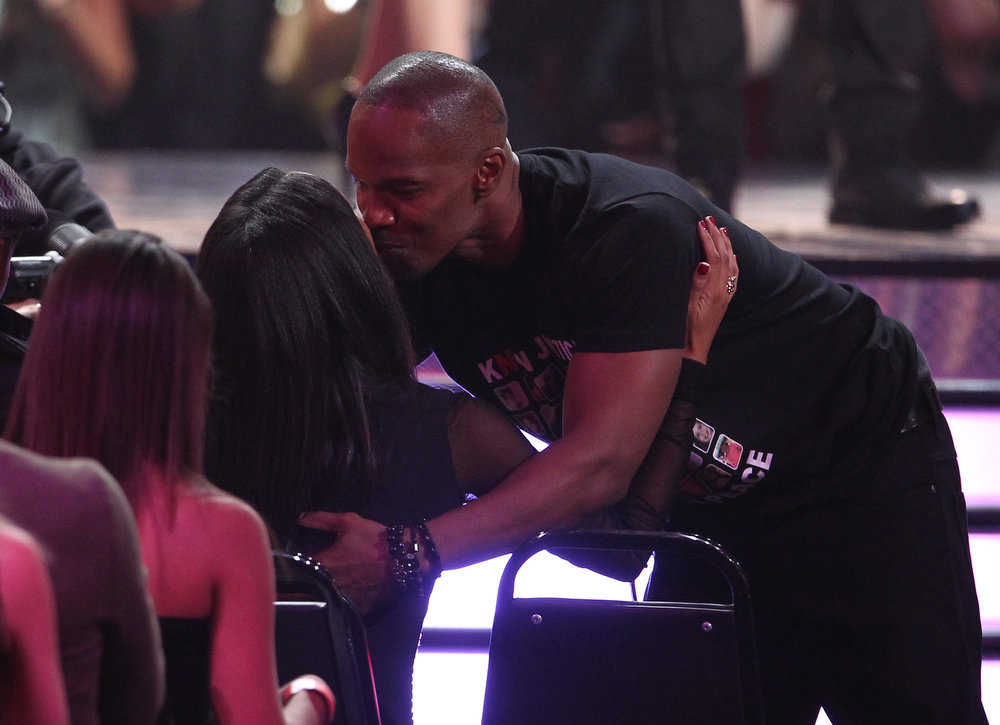 ". Jamie Foxx hugs his daughter before accepting the award for best WTF moment for ""Django Unchained\"" at the MTV Movie Awards in Sony Pictures Studio Lot in Culver City, Calif., on Sunday April 14, 2013. (Photo by Matt Sayles/Invision /AP)"