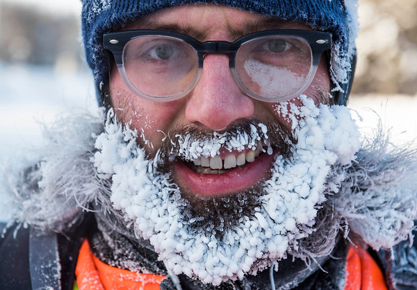 Jason Bekolay and his ice beard cycle to work Wednesday January 4, 2016. (David Lipnowski for Metro News)