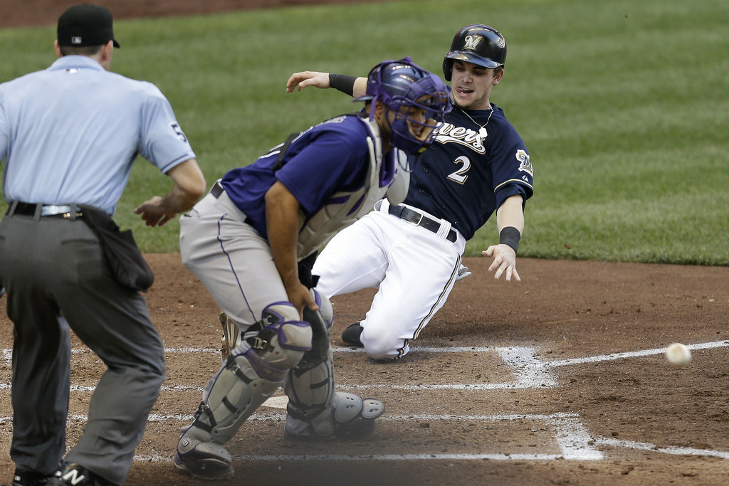 . MILWAUKEE, WI - JUNE 28: Scooter Gennett #2 of the Milwaukee Brewers beats the throw to Wilin Rosario #20 of the Colorado Rockies during the bottom of the fifth inning at Miller Park on June 28, 2014 in Milwaukee, Wisconsin. (Photo by Mike McGinnis/Getty Images)